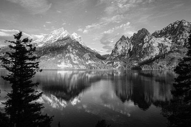 Grand Teton and Storm Point, reflected off the waters of Jenny Lake.