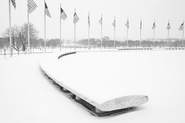 The base of the Washington Monument, covered in snow.