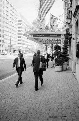 People walking in front of the Mayflower Hotel on Connecticut Avenue NW.