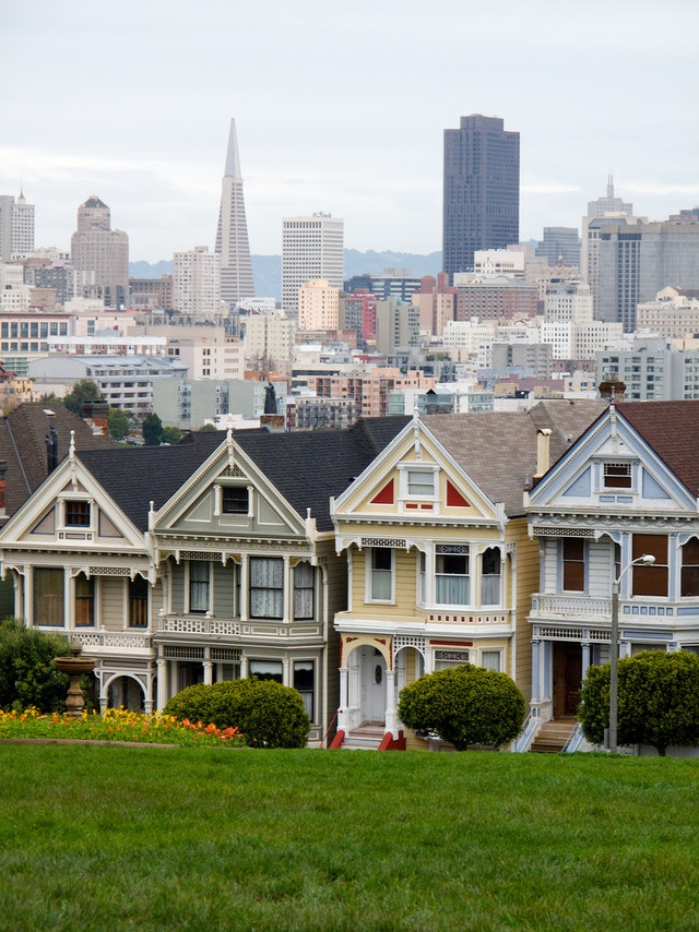 Alamo Square, San Francisco, with the Painted Ladies of Postcard Row in the foreground and the Transamerica Pyramid and part of the San Francisco skyline in the background.