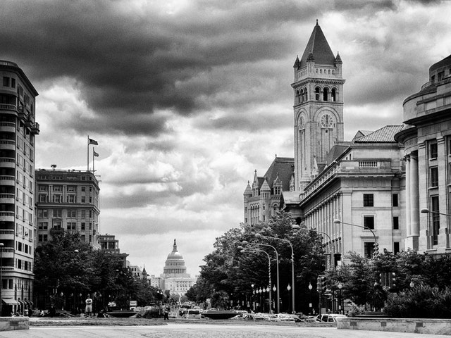 Pennsylvania Avenue from Freedom Plaza, with the Capitol and the Old Post Office in the background.