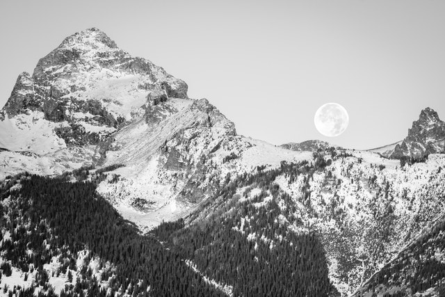 The Moon setting behind the Tetons.