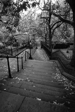 Steps descending into a footpath at the western end of Princes Street Gardens in Edinburgh.
