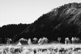 The T.A. Moulton barn at sunrise, next to Blacktail Butte, in Grand Teton National Park.