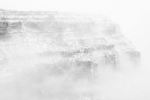 Maricopa Point shrouded in fog during a snowstorm, seen from Grand Canyon Village.