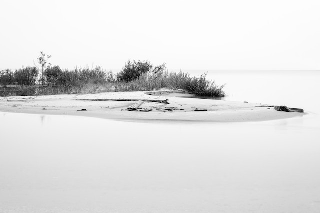A long exposure photo of a sandy key at the mouth of the Platte River.