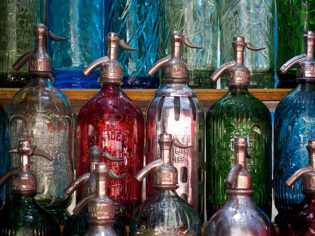 Antique glass seltzer bottles at the Feria de San Telmo in Plaza Dorrego, Buenos Aires.