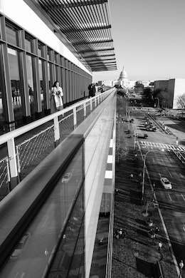 A woman walking along the terrace of the Newseum in Washington, DC.