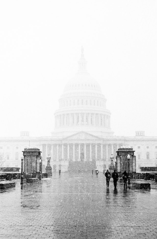 The United States Capitol in the snow.