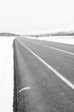 The road next to Teton Point Turnout, looking south towards Moose.