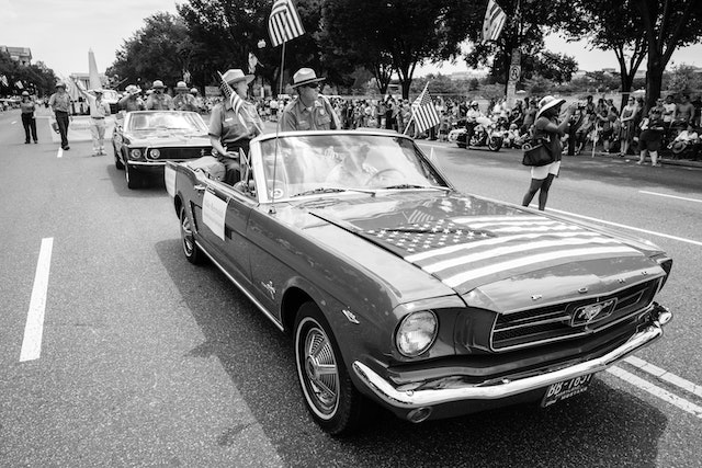Gay Vietzke and Mike Reynolds, Superintendent of the National Mall & Memorial Parks and Director of the National Park Service, riding on the back of a Mustang at the Independence Day parade in Washington, DC.