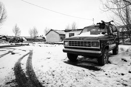 A snow-covered Ford Bronco parked in Jackson, Wyoming.