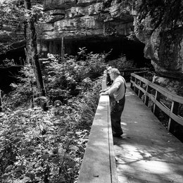 A man looking at the Russell Cave in Alabama.