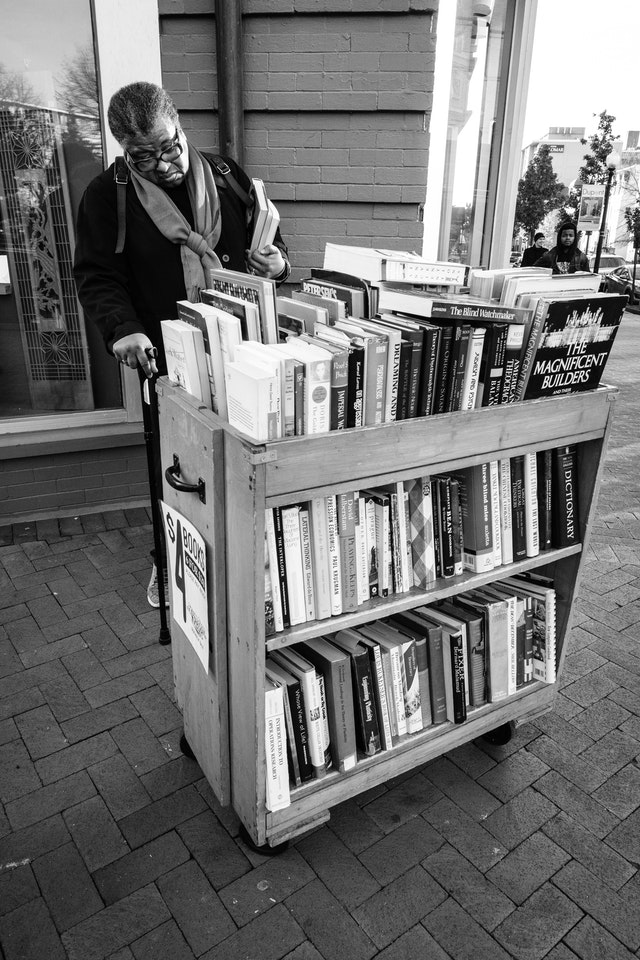 A woman looking at books at an outdoor stand outside Second Story Books near Dupont Circle.