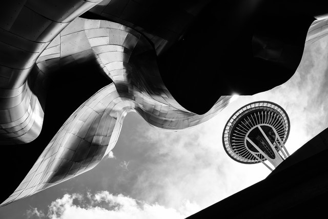 The Space Needle in Seattle, seen in the clouds through the structure of the Museum of Pop Culture.