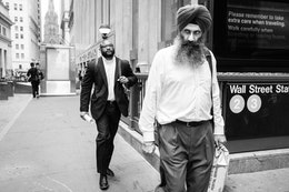 A Sikh man walking on Wall Street in New York.