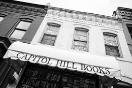 Capitol Hill books in Eastern Market, showing its second-story windows completely covered in books.