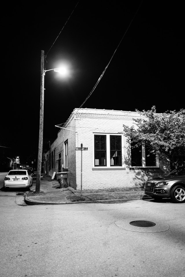 A house on the corner of Williams Street and 17th Street in Southside Chattanooga, at night.