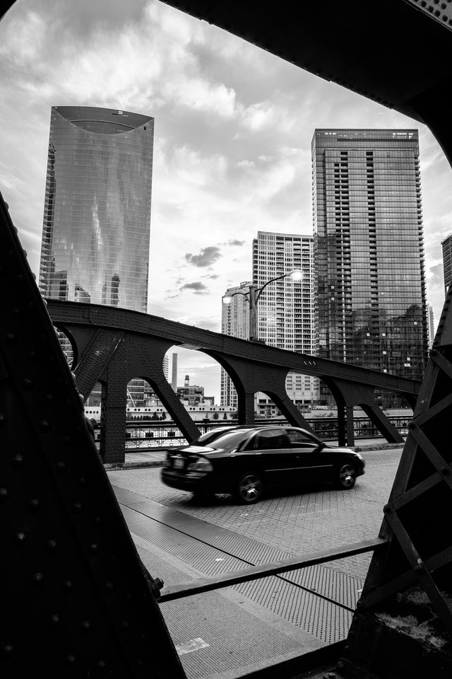 A car driving over the Franklin Street Bridge in Chicago.