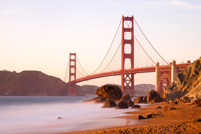 The Golden Gate bridge bathed in golden light at sunset, from Marshall's Beach.