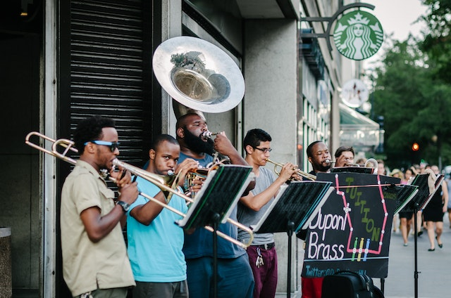 Dupont Brass, playing music in front of the Farragut North Metro Station in Washington, DC.