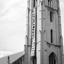 The Church of the Pilgrims in Washington, DC, featuring a large banner with the hashtag #BlackLivesMatter.