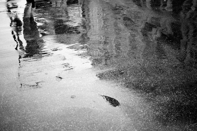 Buildings reflected off of the wet pavement near Metro Center.