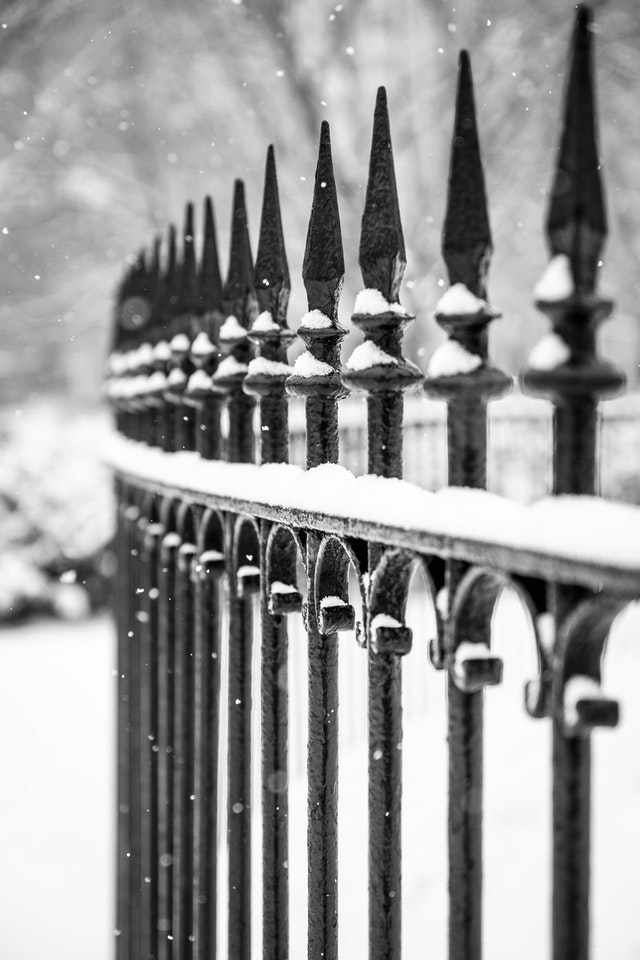 Snow piling on an iron fence at Lafayette Square.