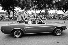 Park Rangers riding on the back of a Mustang at the Independence Day parade in Washington, DC.