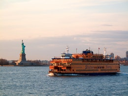 The Guy V. Molinari Ferry in front of the Statue of Liberty.