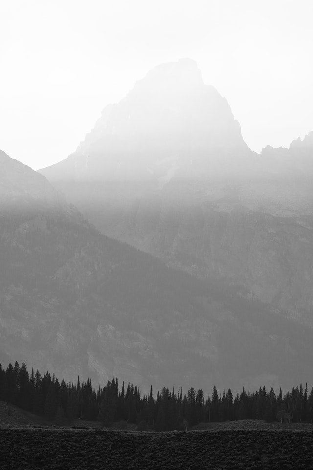 Grand Teton, at sunset. Streaks of sunlight are visible in the smoke from the California wildfirs.