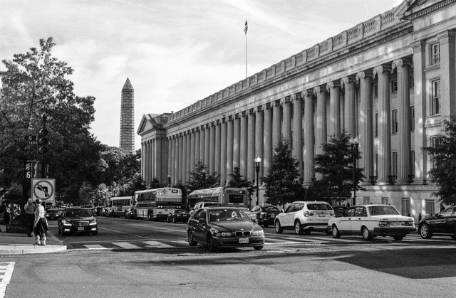 Car traffic in front of the Treasury Building in Washington, DC.