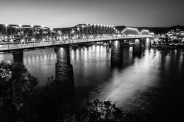 A long exposure photograph of the Walnut Street Bridge, from the Hunter Museum.