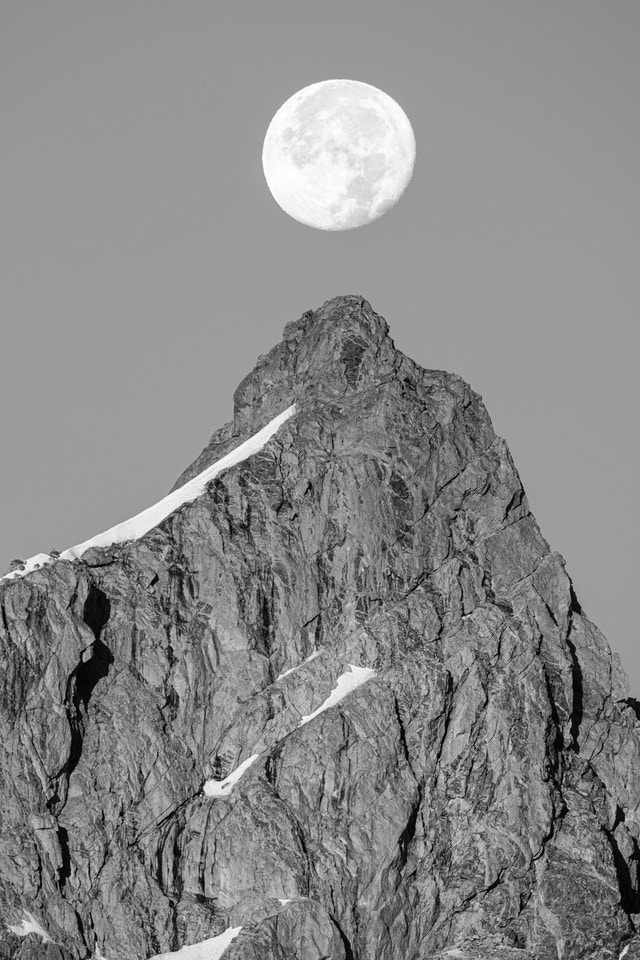 The Moon, hanging directly over the summit of Grand Teton.