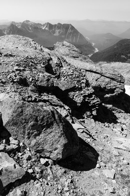 Jagged rocks at the very top of the Skyline Trail on Mount Rainier National Park, with the Nisqually River in the distant background.