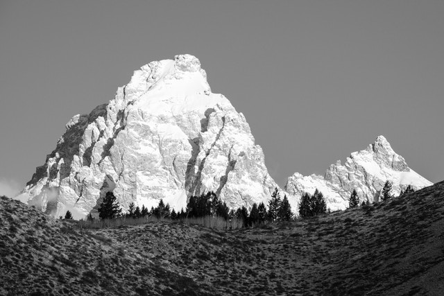 Grand Teton and Mount Owen, seen from the Gros Ventre road. The top of Blacktail Butte is seen in the foreground.